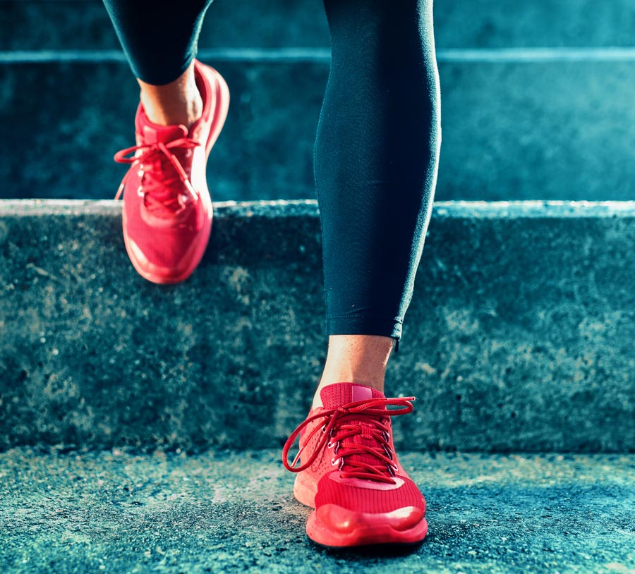 Woman wearing red running shoes