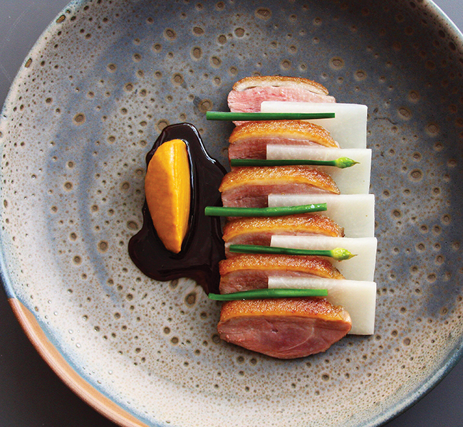 A photo of Dry Aged duck breast with fermented coffee jus and pickled turnip from Est.