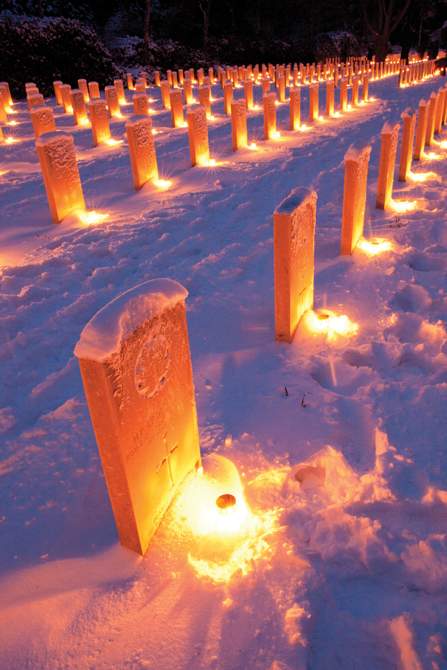 Candles lit at the headstones in the Canadian cemetery in Holten.