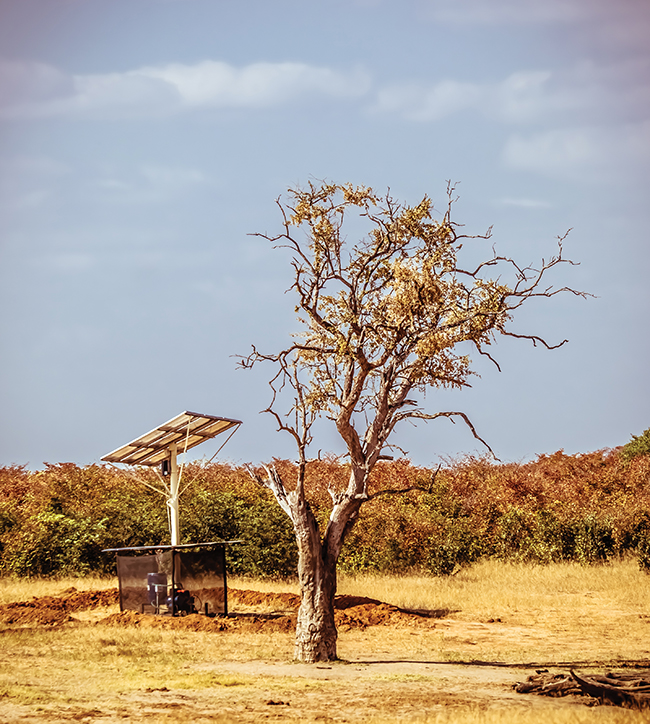 A solar-powered water well.