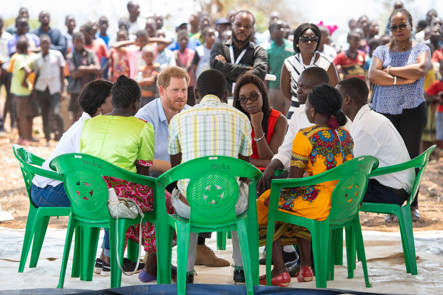 Prince Harry, Duke of Sussex takes part in a discussion with young people during a visit to the Mauwa Health Centre on day nine of the Royal tour of Africa.