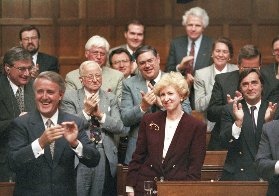 Kim Campbell, Leader of the Conservative Party and Prime Minister designate is given a standing ovation in the House of Commons by Prime Minister Brian Mulroney and other members of the government on June 16, 1993.