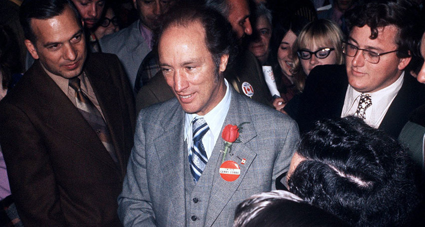 Prime Minister Pierre Trudeau stands among supporters and well wishers on election night Oct. 30, 1972. (CP PHOTO/ Peter Bregg)