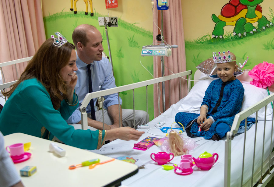 Prince William, Duke of Cambridge and Catherine, Duchess of Cambridge meet with Wafia Remain 7, while on a visit to Shaukat Khanum Memorial Cancer Hospital in Lahore, Pakistan.