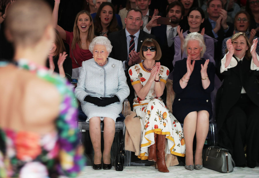 Britain's Queen Elizabeth II, accompanied by British-American journalist and editor, Anna Wintour and royal dressmaker Angela Kelly, views British designer Richard Quinn's runway show during her visit to London Fashion Week's BFC Show Space in central London.