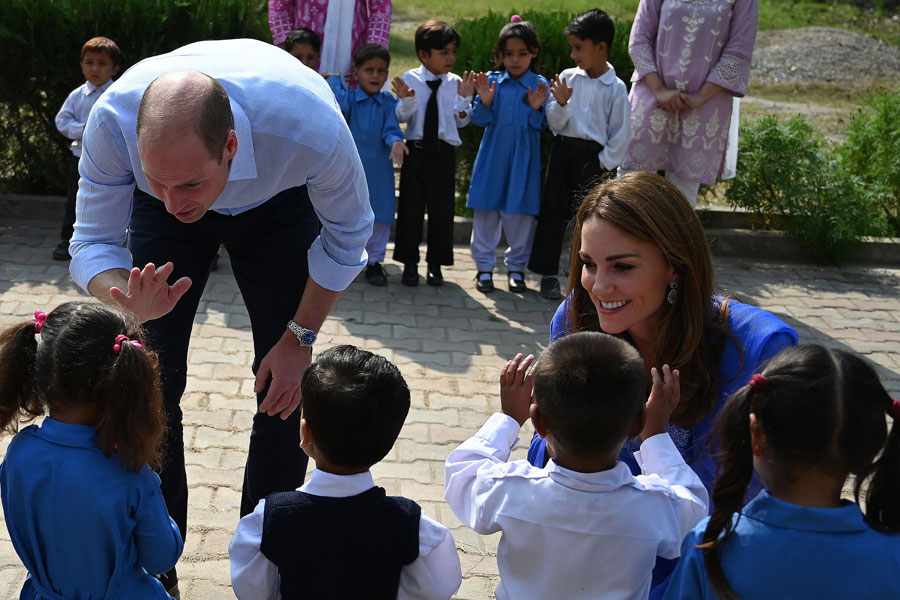 Britain's Prince William, Duke of Cambridge, and Catherine, Duchess of Cambridge, meet with school children during their visit to a government-run school in Islamabad, Pakistan.