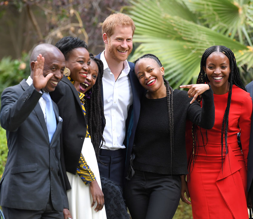 Prince Harry, Duke of Sussex poses for photos with attendees at a reception celebrating the UK and South Africa's important business and investment relationship at the High Commissioner's Residence.