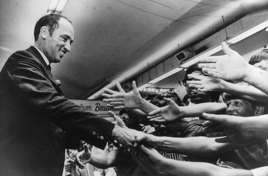 Canadian Prime Minister Pierre Elliot Trudeau shakes hands with admirers at the opening of the Canadian National Exhibition.