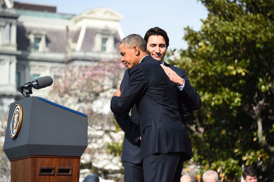 US President Barack Obama and Canada's Prime Minister Justin Trudeau hug during a welcome ceremony during a State Visit on the South Lawn of the White House. Photo: Jim Watson/AFP/Getty Images)