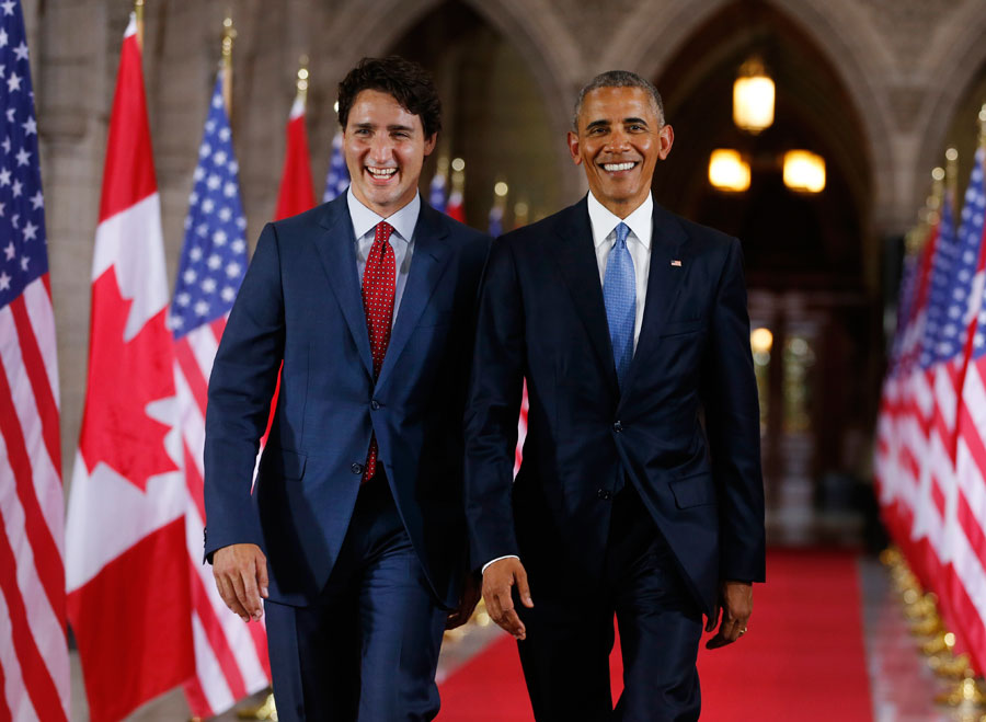 Prime Minister of Canada Justin Trudeau and US President Barack Obama exit the Hall of Honour on Parliament Hill following the North American Leaders Summit in Ottawa. Photo: Chris Roussakis/AFP/Getty Images