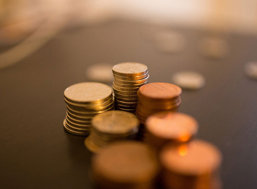 Stacks of coins out of focus