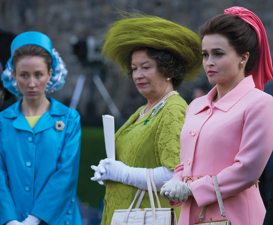 Erin Doherty, Marion Bailey and Helena Bonham Carter depict Princess Anne, the Queen Mother and Princess Margaret at the investiture of Prince Charles as the Prince of Wales, 1969.