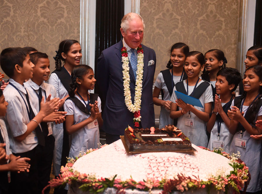 Britain's Prince Charles interacts with children from the Kaivalya Education Foundation supported by the British Asian trust.