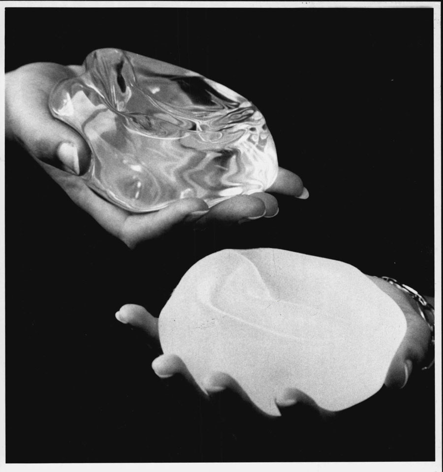 A 1992 photo showing a smooth implant, left, and a textured implant, right, the same year the U.S. Food and Drug Administration warned manufacturers that their products were unsafe