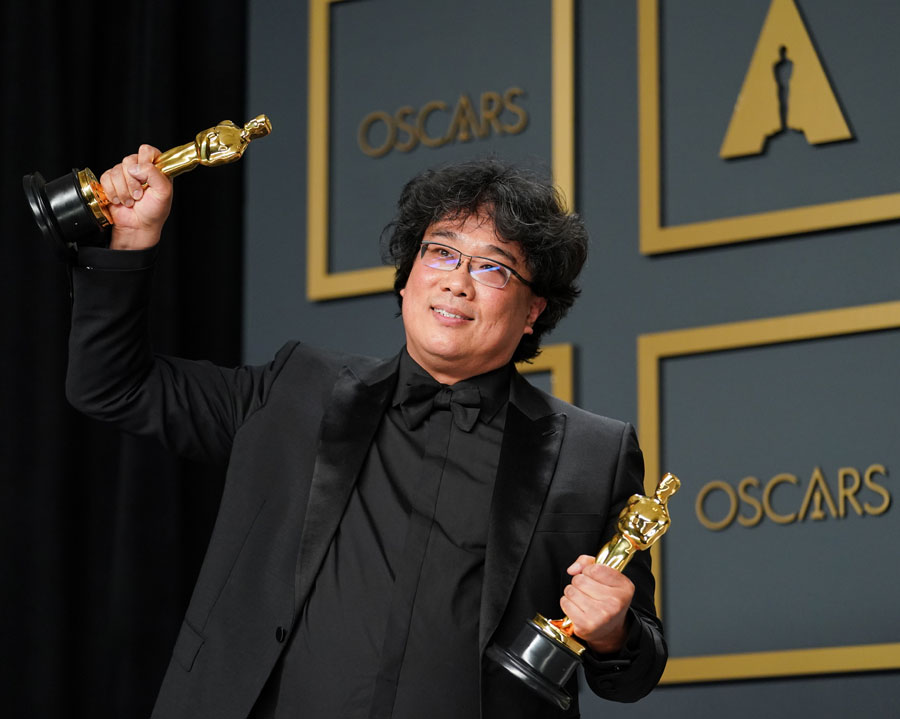 "Bong Joon-ho, winner of the Original Screenplay, International Feature Film, Directing, and Best Picture award for ""Parasite"" at the 92nd Annual Academy Awards. Photo: Rachel Luna/Getty Images"