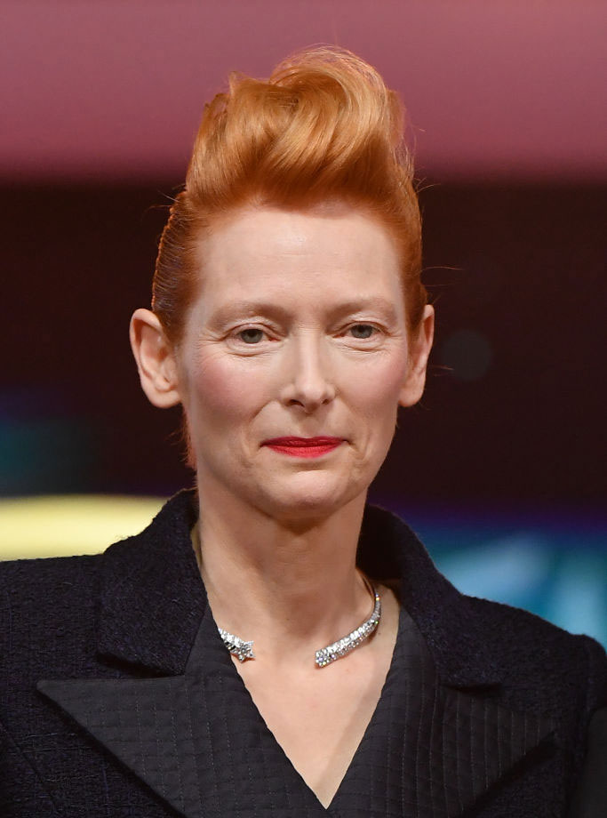 Actress Tilda Swinton, 59, goes for a boyish and ultra cool look by slicking back the side and going for a full pompadour top. Photo: Stephane Cardinale - Corbis/Corbis via Getty Images