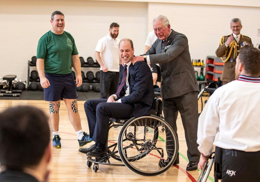 Prince William, Duke of Cambridge has his shoulders rubbed by Prince Charles, Prince of Wales after the Duke attempted and failed to throw a basket ball into the hoop, during a visit to the defence medical rehabilitation centre (DMRC) Stanford Hall on February 11, 2020 in Loughborough, United Kingdom. Photo: Richard Pohle/WPA Pool/Getty Images