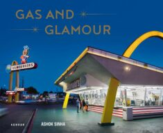 Book cover of a retro McDonalds, shot at a wide angle against a deep blue sky.