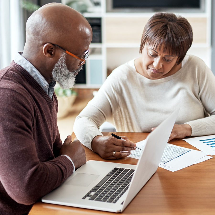 Cropped shot of a senior couple sitting together and going over their financial documents together in their home.