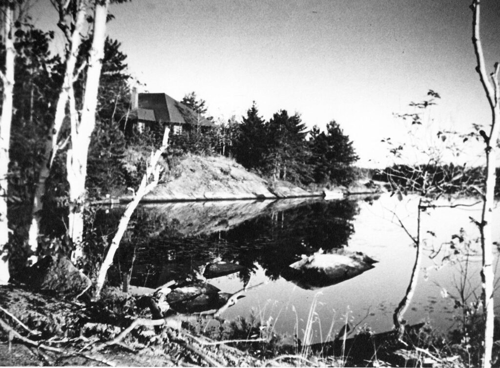 Mary Lawson's cottage on the lake, black and white, 1920.