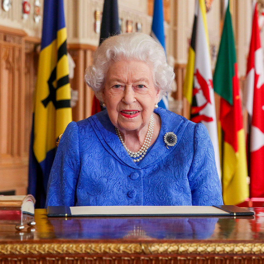 WINDSOR, UNITED KINGDOM: In this undated image released on March 7, 2021, Queen Elizabeth II signs her annual Commonwealth Day Message in St George's Hall at Windsor Castle, to mark Commonwealth Day, in Windsor, England.