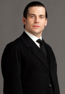 Thomas Barrow, Footman/Lord Grantham's Valet/Underbutler - played by Rob James-Collier