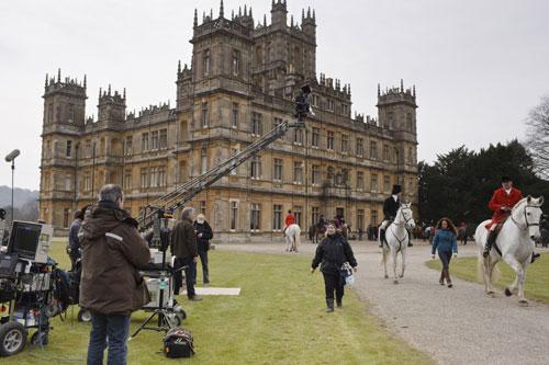 DAS1 BTS: An exterior scene with Highclere Castle looming majestic in the background