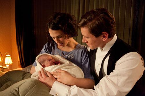 DAS3E4: Sybil and Tom look adoringly at their new daughter