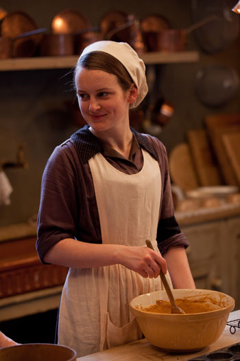 DAS3E5 - BTS: Sophie McShera smiles while stirring the pot