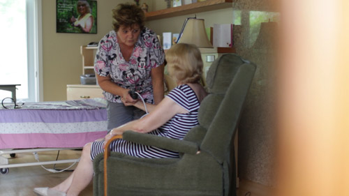 The Trouble With Dying: Nurse with patient in palliative care