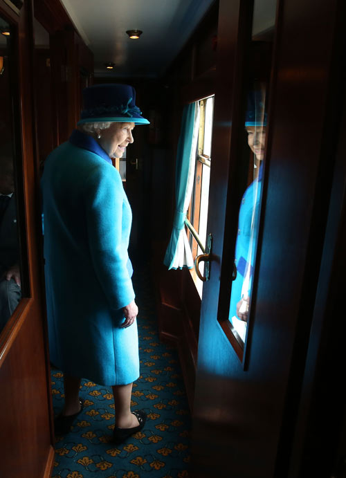 Queen Elizabeth Looks Out Train Window on the Day She Becomes the UK's Longest Reigning Monarch