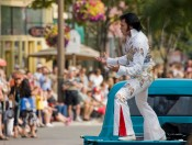 Elvis Parade TA Standing in Truck with Good Crowds - Credit Isis Photography