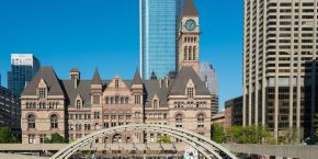 TORONTO, ONTARIO, CANADA - 2015/05/23: Old city hall from across Nathan Phillips Square, against a backdrop of a modern buildings and a bright blue sky, gothic architecture juxtaposed with the contemporary elements. (Photo by Roberto Machado Noa/LightRocket via Getty Images)