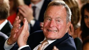 Former President George H. W. Bush applauds during an event to honor the winner of the 5,000th Daily Point of Light Award at the White House in Washington in this file photo from July 15, 2013. Bush was taken by ambulance to the Houston Methodist Hospital as a precaution after experiencing a shortness of breath December 23, 2014, according to a statement from his office.   REUTERS/Kevin Lamarque/Files    (UNITED STATES - Tags: POLITICS)