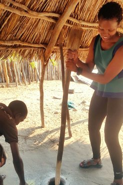 My host siblings are teaching me how to pound mahangu. It's a lot hard than it looks.