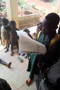 Children in Cameroon reading the books created by students in California