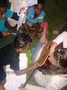 Practicing turn-taking, decision-making, fine motor skills and social skills through music.