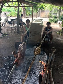 Roasting a lechon baboy (roast pig) with host cousin Jordon, who roasts a turkey