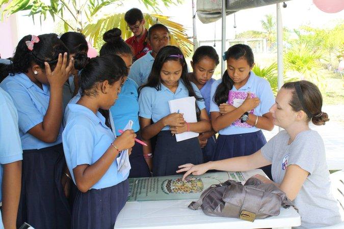 Jessica teaching school children