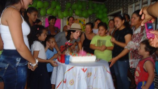 Kaitlyn Saruwatari blowing out the candles