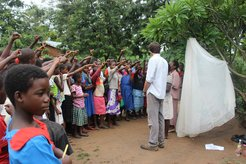 Teaching about mosquito net use