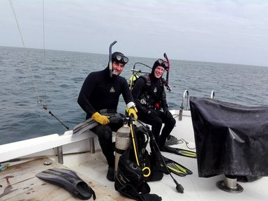 Peace Corps Response volunteer Christopher Giordano (right) with Dr. Yuri Hooker (left) before the first dive of their investigation. They were filming and cataloguing the marine species offshore Cabo Blanco for the first time ever.