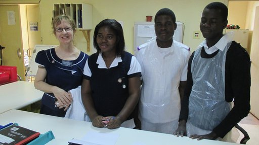 Laurel with a qualified nurse and two student on the male surgical ward