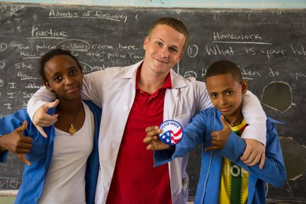 Teacher with students in Ethiopia