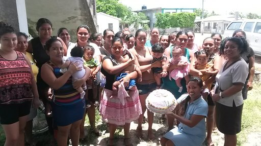 PCV Loryann and mothers in village