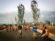 Tingaja walking after collecting lusekwane shrubs