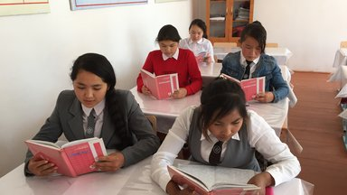 Students reading and taking notes.