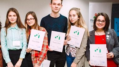 """Youth leaders display certificates after participating in the 2016 """"Ecohackathon"""""""