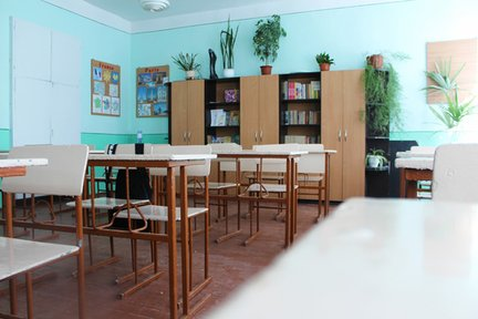 An empty classroom with desks.