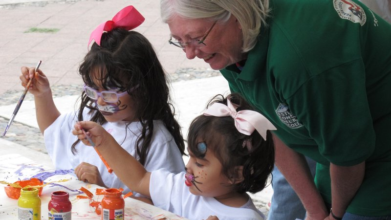 Mary engages a child at an outreach event in Mexico.